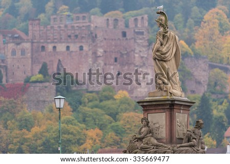 Statue of the old bridge and ruined castle in Heidelberg, Germany - stock photo