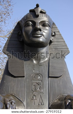 Statue of The Sphinx at Cleopatra`s Needle on Victoria Embankment, London, England - stock photo