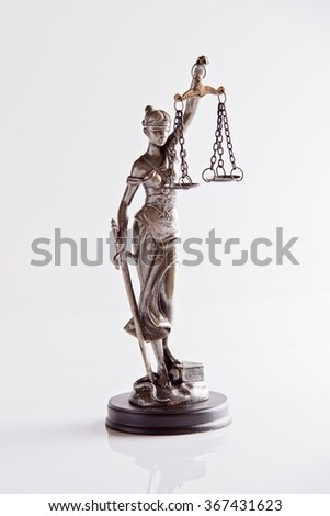 Statue of Themis - goddess of justice on white background - stock photo