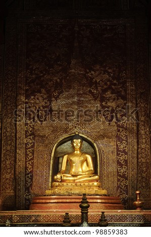 Statue Phra Singh ; Viharn Lai Kam Wat Phra Singh is located in the western part of the old city centre of Chiang Mai. - stock photo