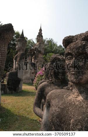 Statues in Buddha Park near Vientiane, Laos - stock photo