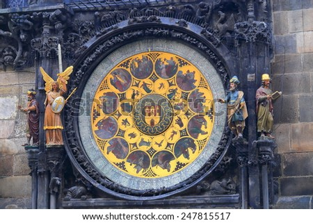 Statues near the golden dial of the Astronomical Clock, Prague Old Town, Czech Republic - stock photo