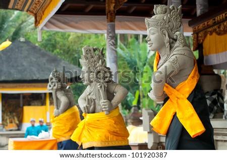 Statues of Balinese demon in Ubud, Indonesia - stock photo