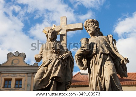 Statues of Jesus Christ and Man and Cross Against Blue Sky - stock photo