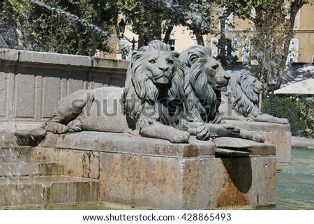 Statues of lions at the Rotunda Fountain in Aix en Provence, France - stock photo