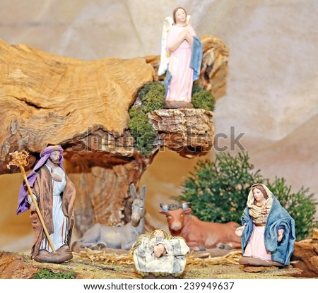statues of the Nativity scene with Holy family traditional Neapolitan style - stock photo