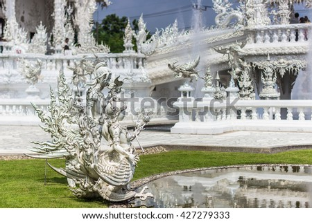 Statues of Wonder in the White Temple, Thailand - stock photo