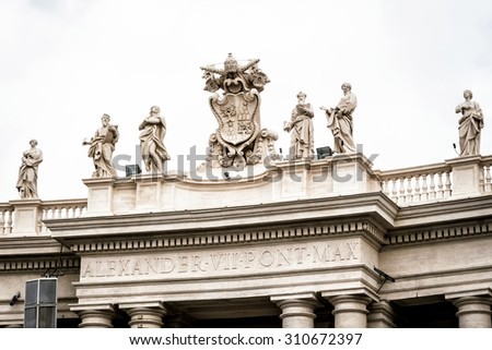 Statues on colonnades that surround St. Peter's Square in Rome - stock photo