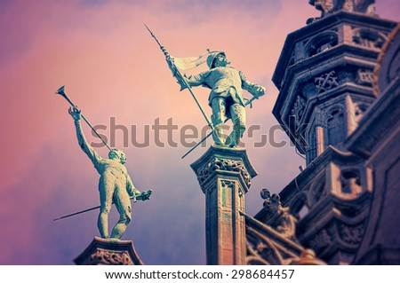 Statues on the roof of King's House or Maison du Roi on Grand Place in Brussels, with vintage look effects applied - stock photo
