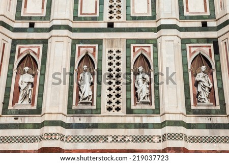 Statues on the side of Giotto's Campanille in Florence, Italy. - stock photo