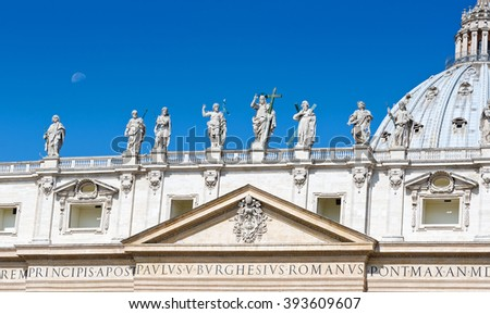 Statues on the Vatican with the moon in the sky during summertime in Rome, Italy - stock photo