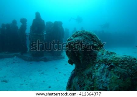 Statues underwater - stock photo