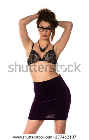 Statuesque brunette in a bra and skirt - stock photo