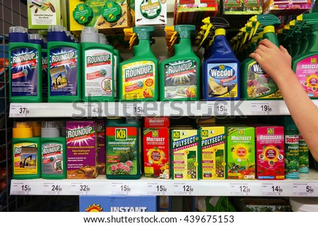 STAVELOT, BELGIUM - MAY 6, 2016: Shelves with a variety of Pesticides in a Carrefour Supermarket. Roundup is a brand-name of an herbicide containing glyphosate, made by Monsanto. - stock photo