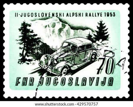 STAVROPOL, RUSSIA - MARCH 30, 2016: a stamp printed in Jugoslavia, shows  rally car. Auto near Mt. Triglav, cirka 1953 - stock photo