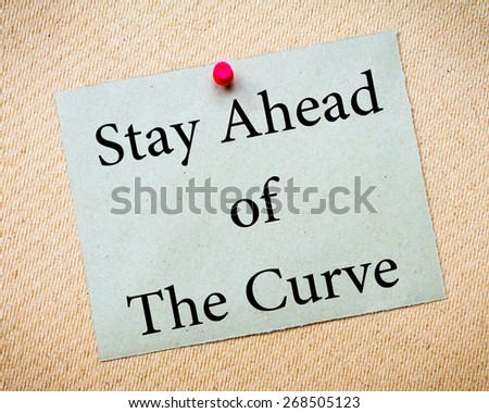 Stay Ahead of the Curve Message. Recycled paper note pinned on cork board. Concept Image - stock photo