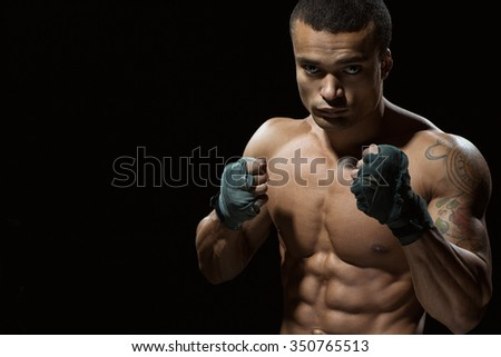Staying focused. Portrait of a young handsome African boxer - stock photo