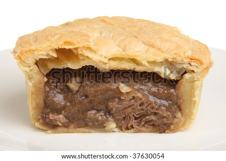 Steak and kidney pie sliced open - stock photo