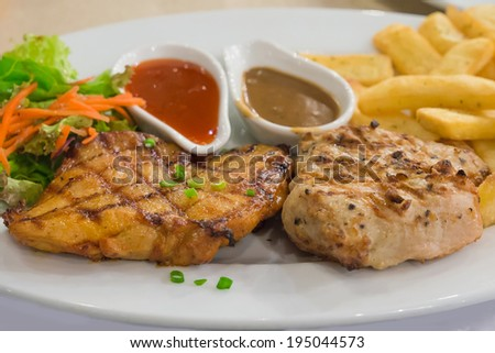 Steak, BBQ Pork and Spicy Chicken with French Fries - stock photo