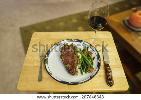 steak dinner with green beans mashed potatoes and mushrooms and a glass of wine - stock photo