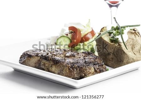 Steak Dinner with salad and potato - stock photo