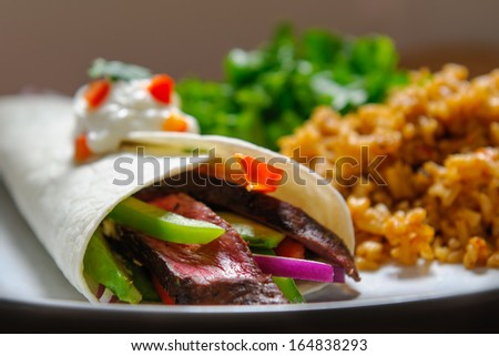 Steak Fajita with mexican rice and salad - stock photo