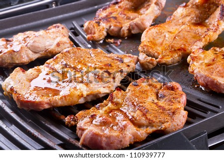 Steak meat grilled on barbecue - stock photo