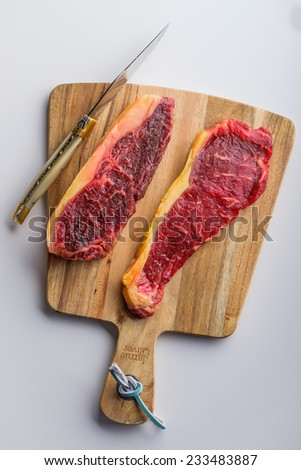Steak on the cutting board - stock photo