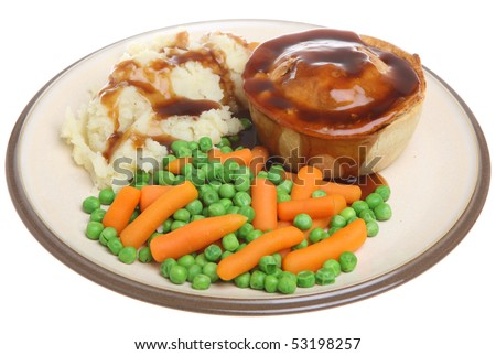 Steak pie with mashed potato, peas, carrots and gravy. - stock photo