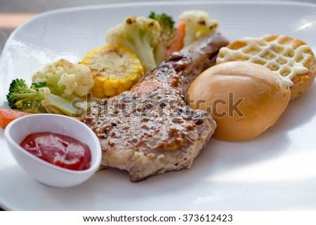 steak pork chop , smoked sausage , sausage , steak , smoked pork chop  - stock photo
