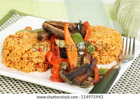 steak strips and sweet peppers with piri piri rice - stock photo