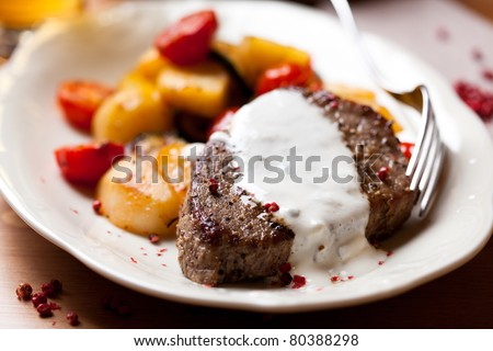 Steak with baked vegetables and sauce - stock photo