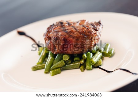 steak with beans - stock photo