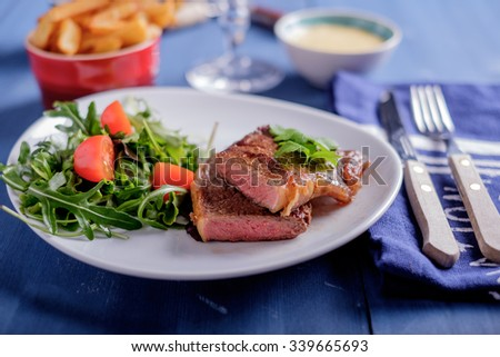 Steak with pomme frites and bearnaise sauce - stock photo