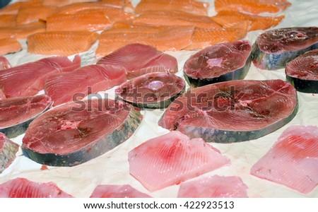 steaks fresh tuna on display fish market - stock photo