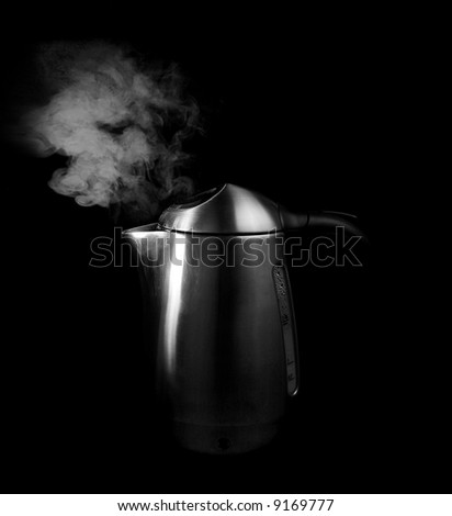 steam and boiling water in a silver tea kettle - stock photo