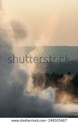 Steam and spray of a geyser in Yellowstone National Park, Wyoming, USA - stock photo