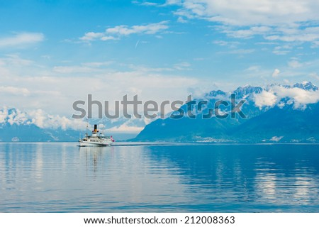 Steam boat with swiss flag floating on the lake Geneva - stock photo