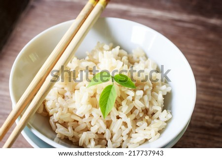 steam brown rice in china cup - stock photo