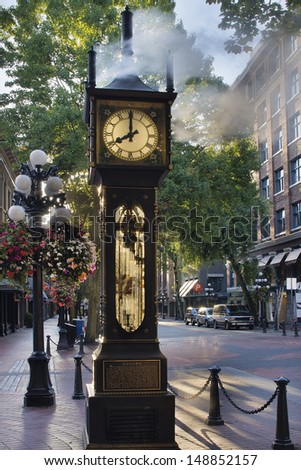 Steam Clock at Gastown Vancouver BC Canada at Eight AM in the Morning with Sunlight - stock photo