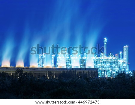 Steam cooling tower of oil refinery plant. - stock photo