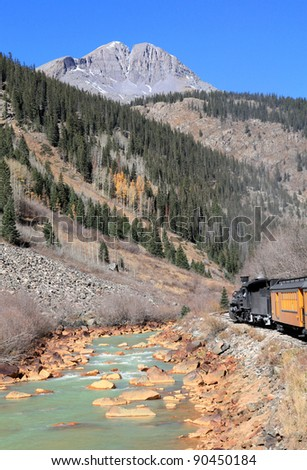 Steam Engine,Train Traveling Through the Rocky Mountains - stock photo