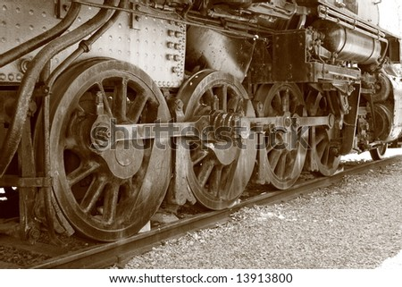 Steam Engine Wheels In Sepia - stock photo