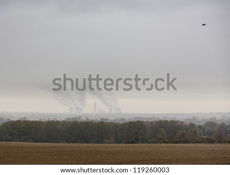 Steam from cooling towers of Didcot power station on cloudy rainy foggy day - stock photo