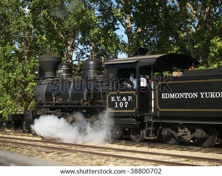 Steam is released in the drive stroke from a restored locomotive done up as an engine of the long defunct (1909) C Y & P Railroad - stock photo
