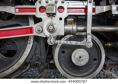 Steam locomotive crank and wheel close up - stock photo