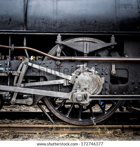 steam locomotive geared wheels close-up  - stock photo