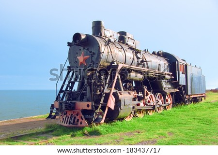 Steam machine on train station. Shore of Lake Baikal (Russia) - stock photo