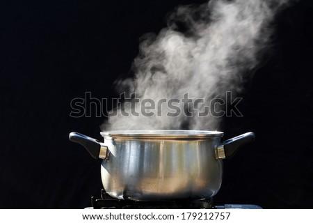 steam on pot in kitchen - stock photo