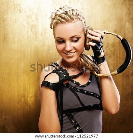 Steam punk girl with headphones - stock photo